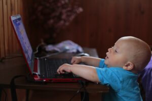 Baby talking with grandparent on the computer